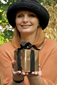 Mature woman holding gift, portrait