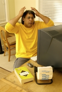 Man struggling with computer